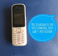 Telefon mit Infosticker