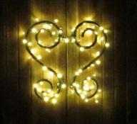 Auf dem Bild sieht man das gut2-Logo, das mit einer Lichterkette beleuchtet ist.