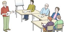 ein Bild mit Menschen die unterrichtet werden.