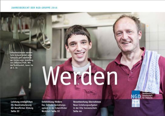 Bild: Zwei Männer stehen nebeneinander. Sie lächeln in die Kamera.