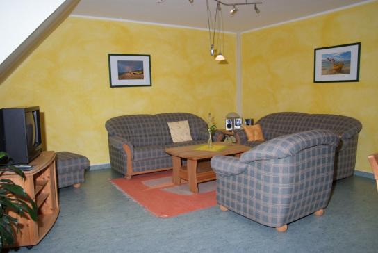 Das Wohnzimmer in der Ferienwohnung mit seiner gemütlichen Sitzecke